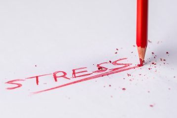 Image of the word stress with red pencil