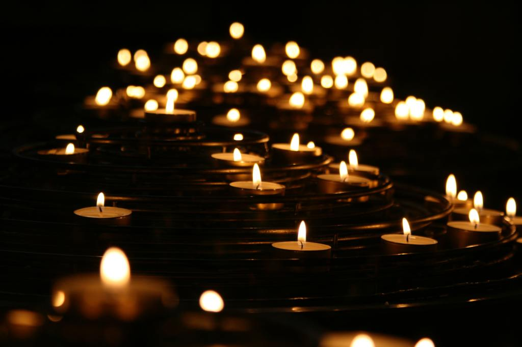 A sea of candles lighting the dark.